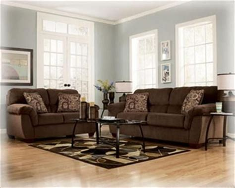 brown couch with pale blue grayish walls living room