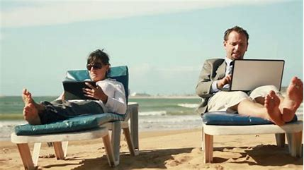 Image result for image of a woman with a laptop at the beach