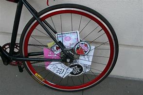 Image result for photos of bicycles with cards in the spokes