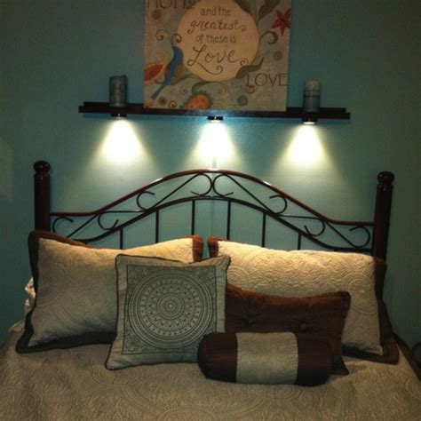 shelf above bed complete with adjustable reading lights