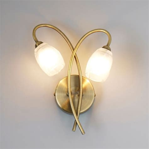 forbes clear antique brass effect wall light departments