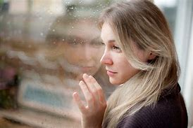 Image result for WOMAN LOOKING OUT WINDOW