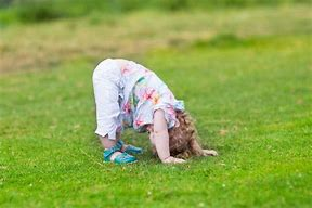 Image result for free pictures of child standing on its head