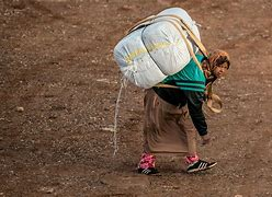 Image result for free pics of people carrying large loads of baggage on their backs