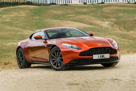ASTON MARTIN DB COUPE REVIEW TRIMS SPECS AND