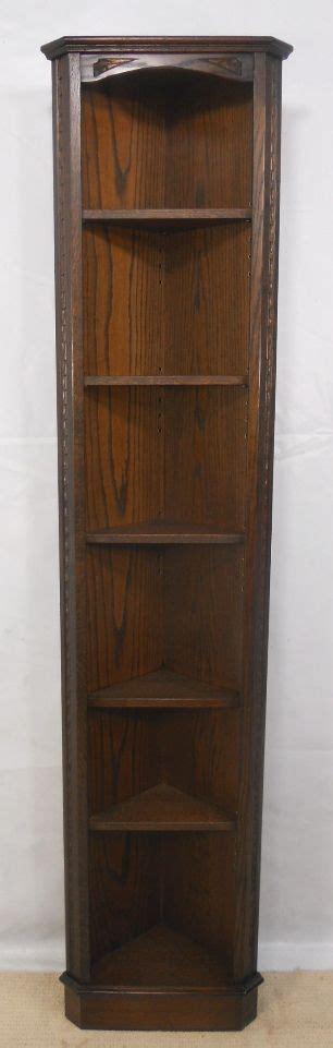 tall narrow free standing dark oak corner cabinet by