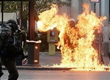 Image result for fire bomb thrown at a cop