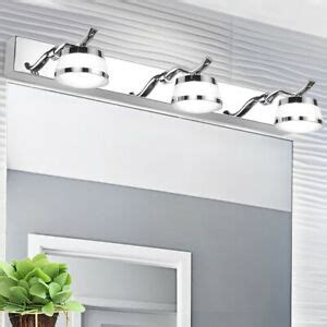 led wall mounted fixture above mirror bath makeup picture