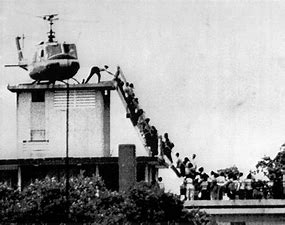 Image result for images last day in vietnam helicopter on roof of embassy