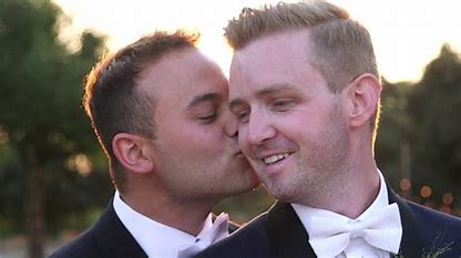 Image result for images two gay men kissing on altar of marriage