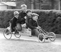 Image result for photos of country children on scooters, soap box cars and bikes