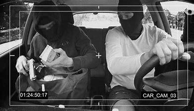 Image result for images two black criminals fleeing in a car