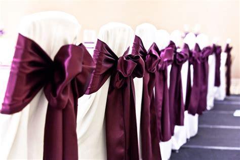 wedding decor chair covers w purple sash nobach