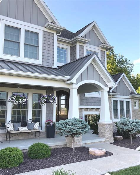 grey and stone craftsman style home exterior caroline on