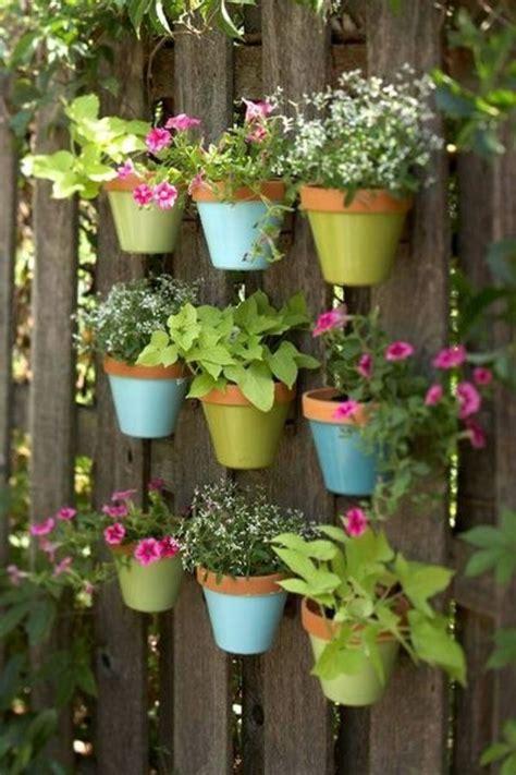 blumentöpfe selber machen schöne dekoration für den zaun