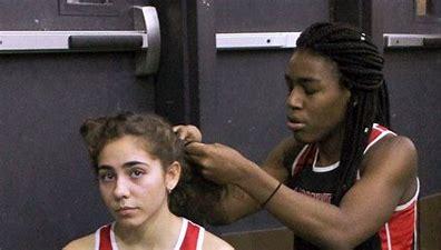 Image result for images transgender athletes hugged by biden