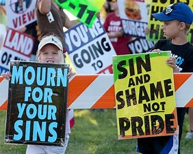 Image result for holding signs in front of church