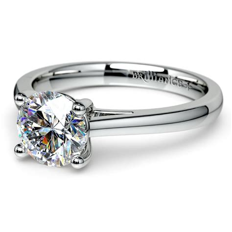 petite round moissanite solitaire ring in white gold mm