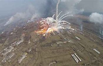 Image result for images exploding munition warehouses in syria