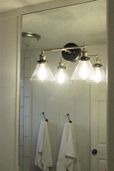 how to mount a light on top of a mirror bathroom vanity