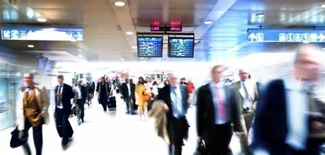 Blur of passengers walking through an airport lounge