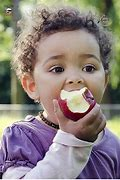 Image result for child eating a apple