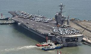 Image result for aircraft carrier transmitting electricy on shore