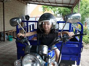 Image result for Tricycle boy breaks record on track