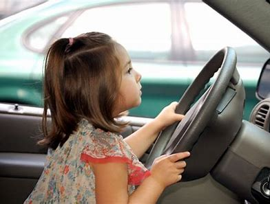 Image result for kid at the wheel of a car