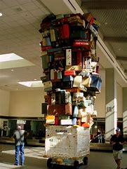 Image result for free pictures of girl carrying a lot of luggage