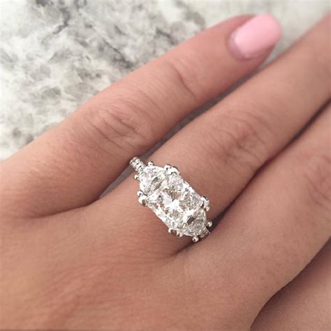 solitaire vs halo engagement rings decision