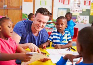 Image result for image student volunteer reading to preschool children