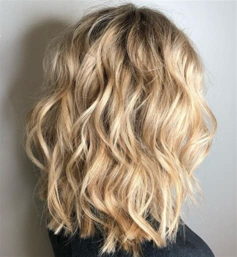 most magnetizing hairstyles for thick wavy hair