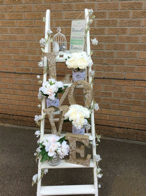 white ladder of love with rustic love letters and jars of