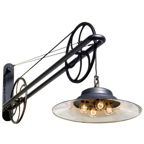 large pulley industrial swing arm lamp at stdibs
