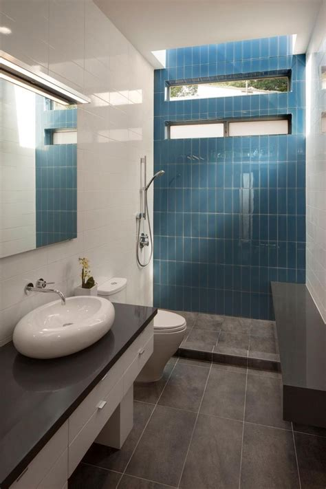 bright blue tile accent wall shower
