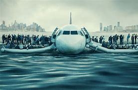 Image result for picture of plane on hudson with passengers on wings
