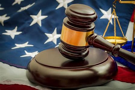 American judicial system pic with gavel and american flag