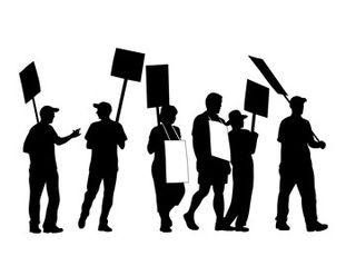 Silhouette of protestors holding signs
