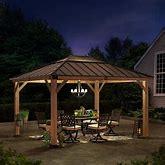 Sunjoy 11 Ft. X 13 Ft. Cedar Framed Gazebo W/ Steel & Polycarbonate Hip Roof Hardtop Wood/Hardtop In Brown, Size 112.8 H X 132.1 W X 154.9 D In