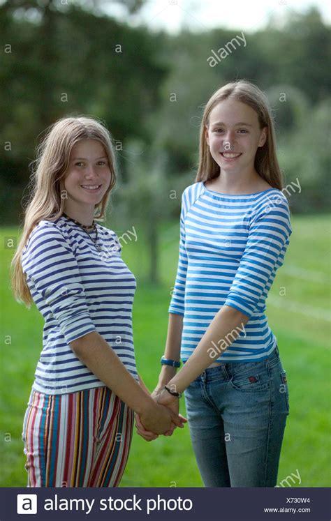 Teenage Girls Holding Hands Smiling